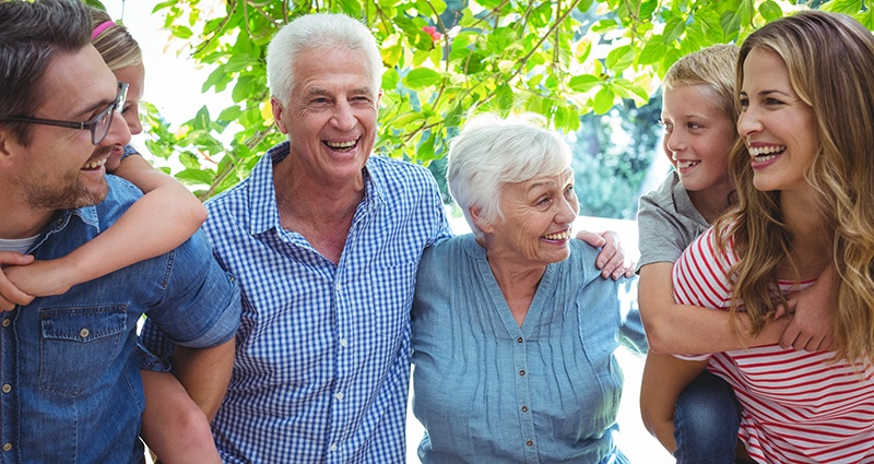 Happiness Couple with family enjoying retirement