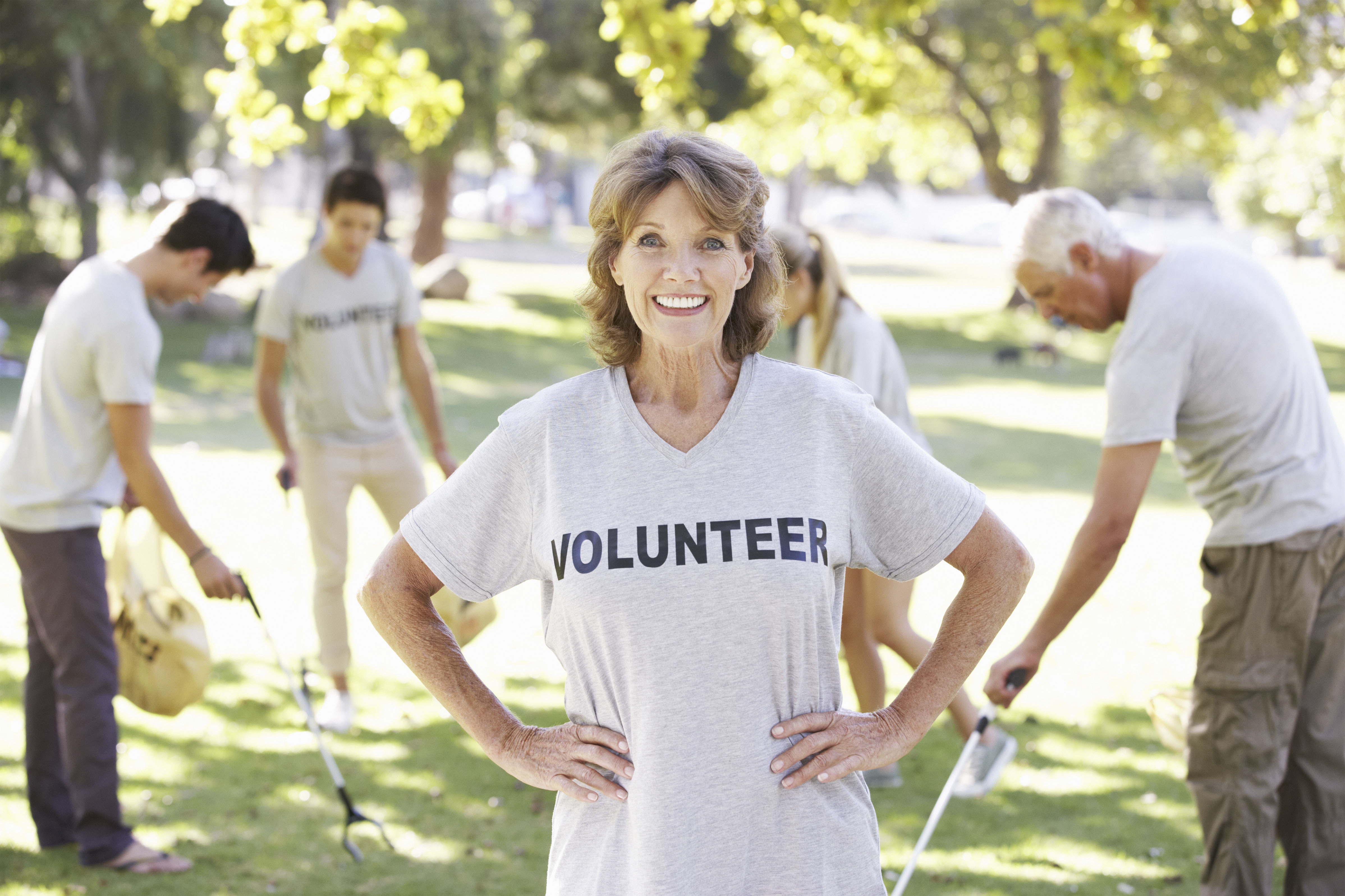 senior woman wearing volunteer shirt