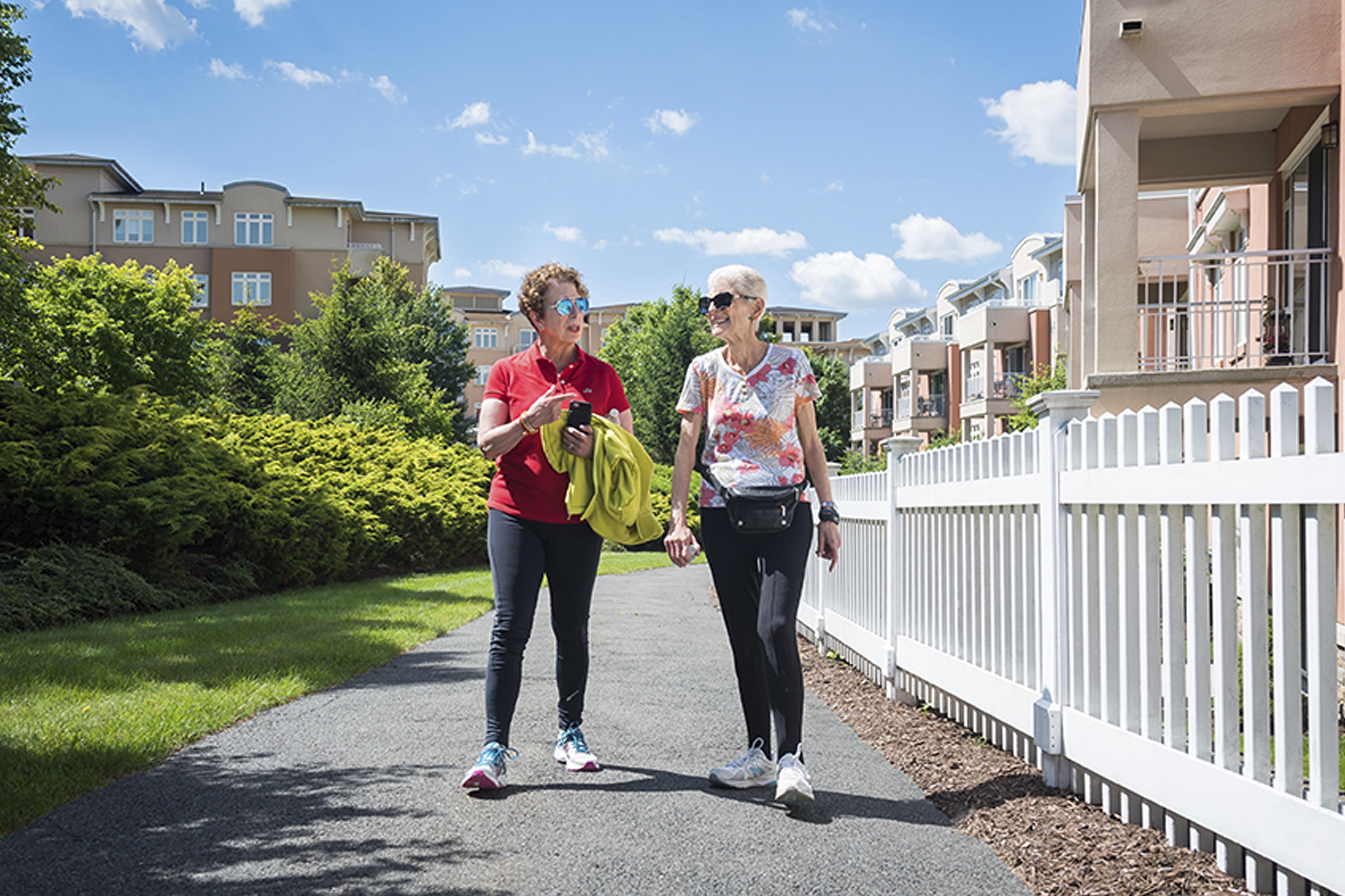 two older adult women walking