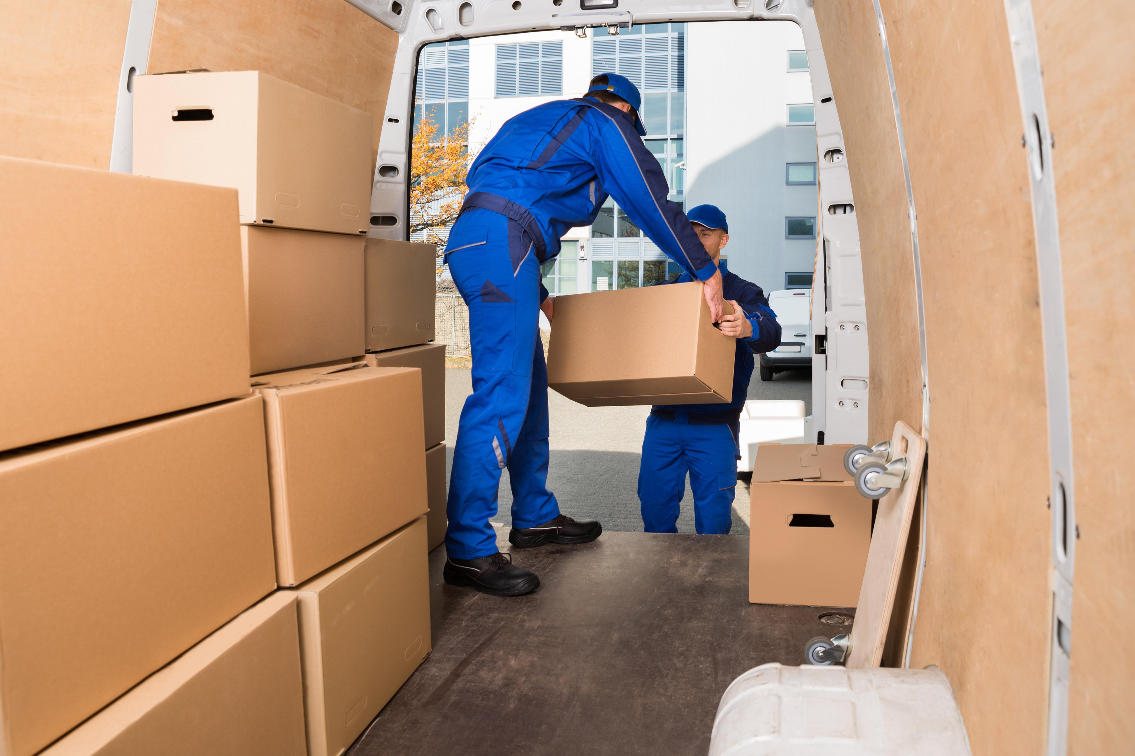 moving men unloading moving boxes